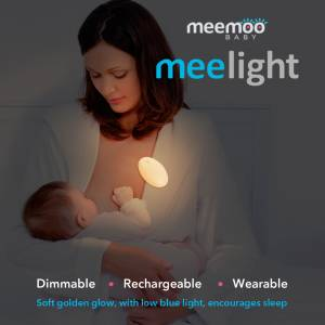 Meelight- mother breastfeeding baby with the Meelight attached to her collar