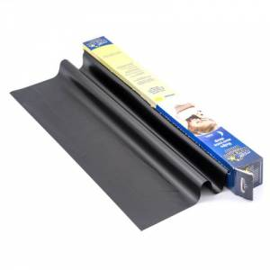 A roll of magic blackout blinds with some of it unrolled